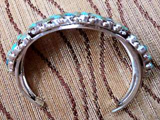 This is a COMPLETELY handcrafted sterling silver bracelet with 69
