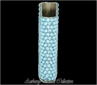 This exquisite cigarette lighter case is covered with Swarovski