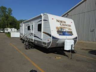 2011 NORTH COUNTRY 28BHSS SINGLE SLIDE TRAVEL TRAILER WITH BUNKS