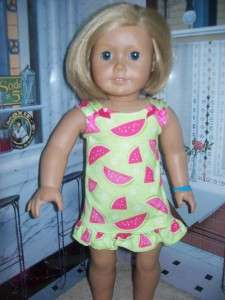 what a doll matching girl and 18 doll outfit. fits American girl doll