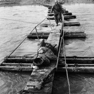 Two US Ninth Army Infantrymen under Intense Machine Gun and Mortar